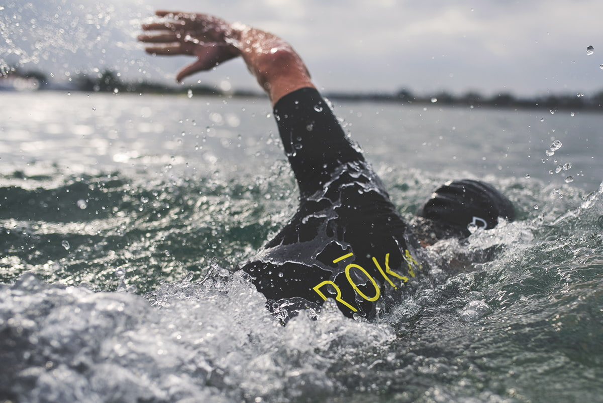 Male swimming in the short sleeve viper pro