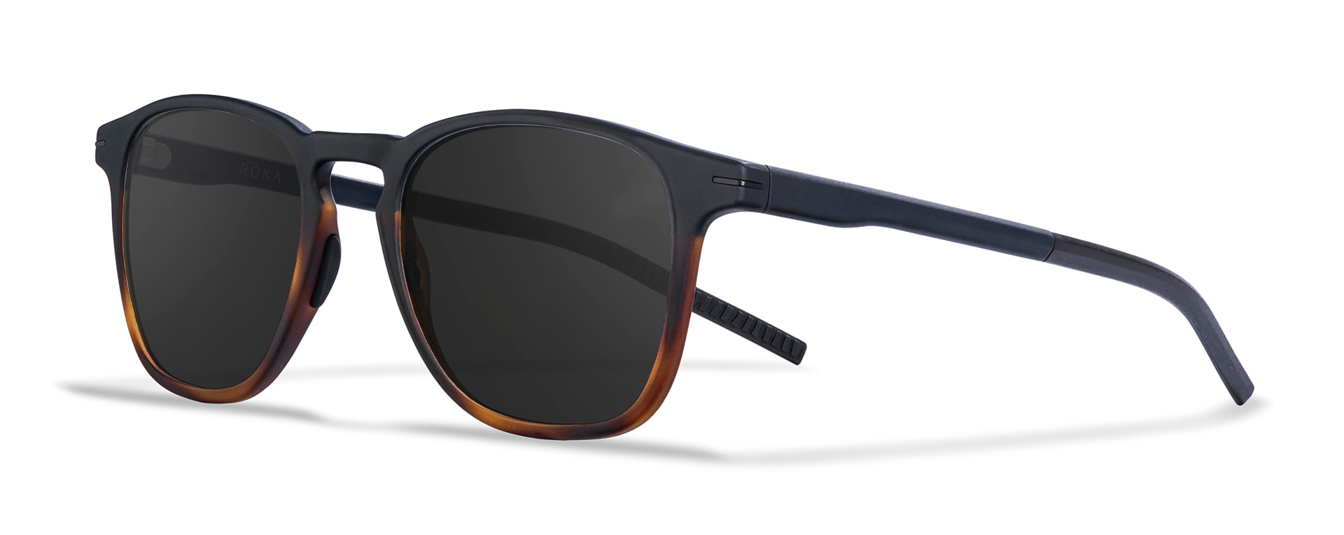 Three-quarter view of the Hunter tortoise fade frame with a dark carbon lens.