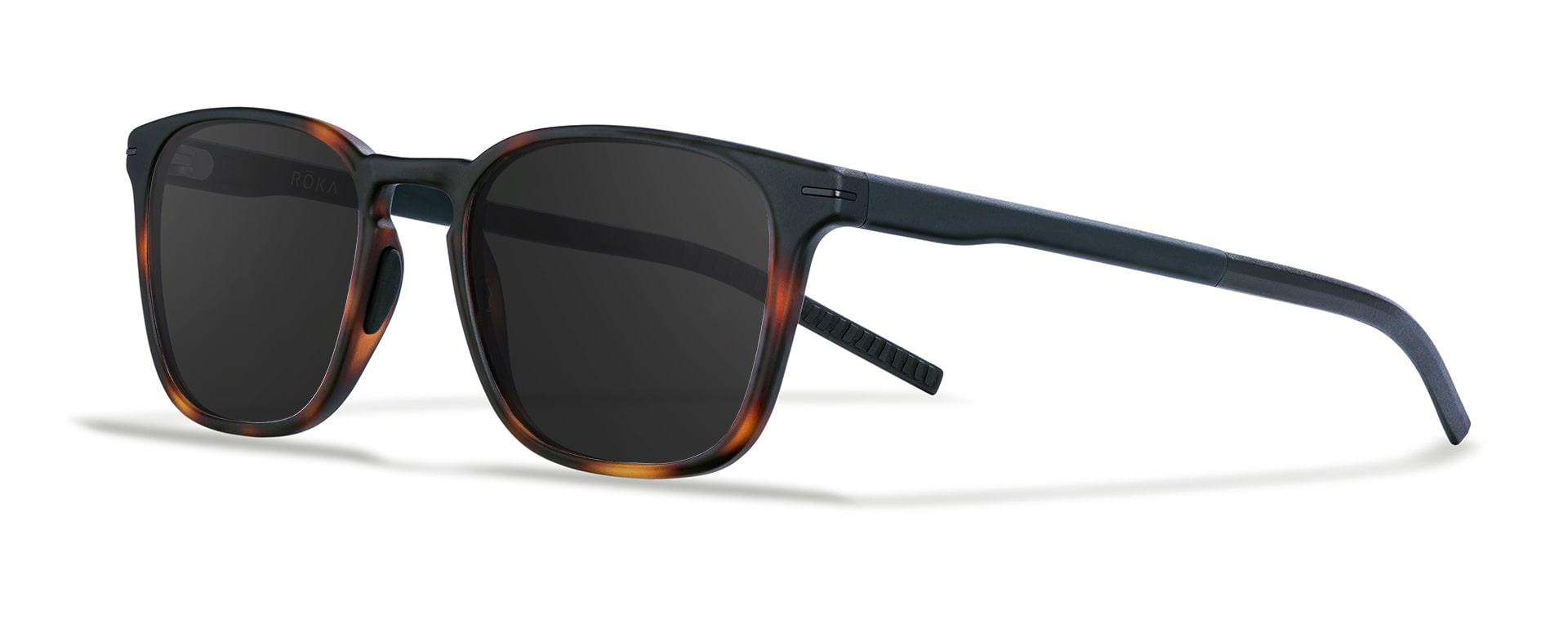 Three-quarter view of the Rory tortoise frame with a dark carbon lens.