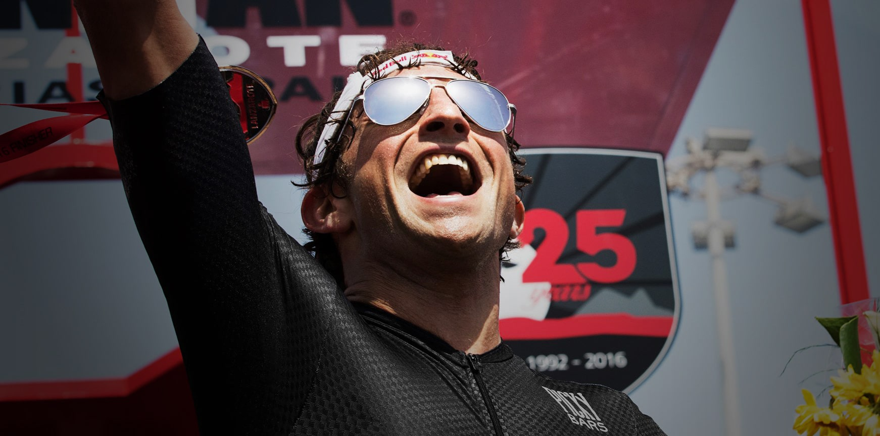 Ironman Champion Jesse Thomas wearing silver phantom aviators